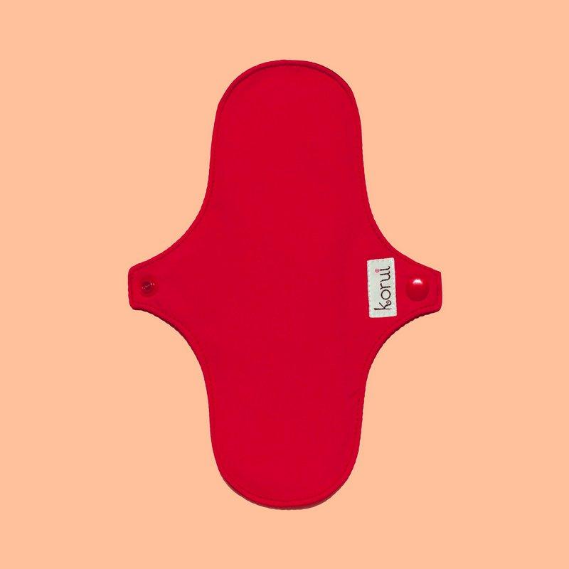 Absorvente da Korui, em pano vermelho
